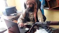 رئیس بانک مرکزی طالبان پشت میز کار + عکس